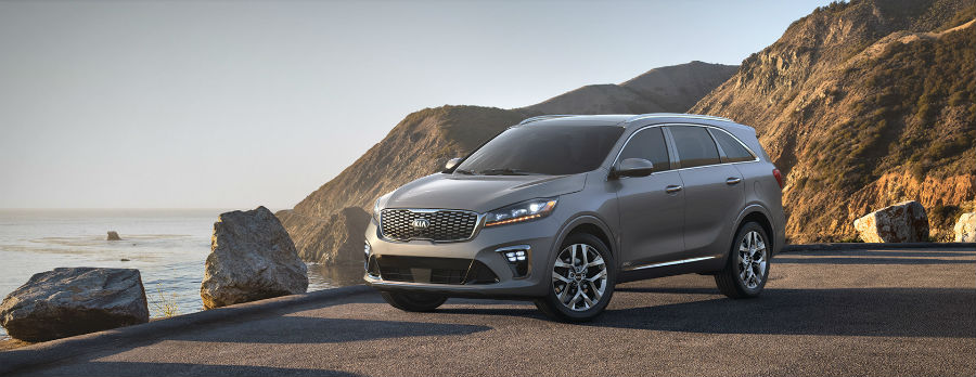 light gray 2019 Kia Sorento exterior front fascia and drivers side on cliff with water