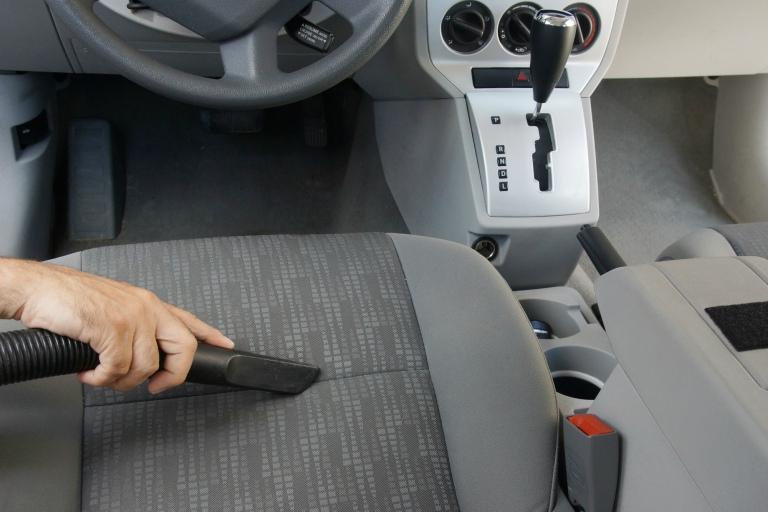 vacuuming car interior