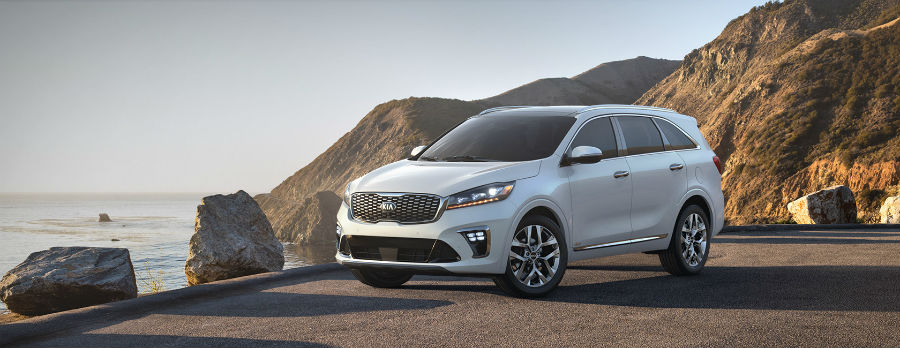 white 2019 Kia Sorento exterior front fascia and drivers side on cliff with water