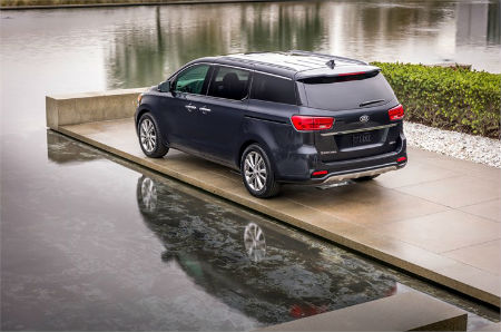 2019 Kia Sedona exterior fascia drivers side parked on tile next to water