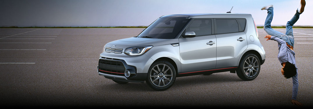 2018 Kia Soul exterior front fascia and drivers side with man doing handstand on the right