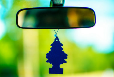 tree air freshener hanging from rear view mirror