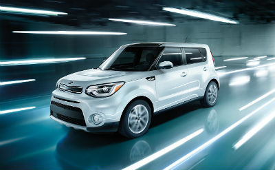 2019 Kia Soul exterior front fascia and drivers side going fast with lights