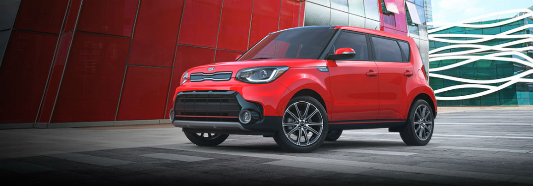 2019 Kia Soul exterior front fascia and drivers side next to city building