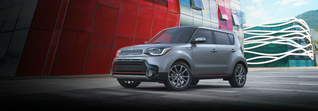 2019 Kia Soul exterior front fascia and drivers side parked in front of strange buildings