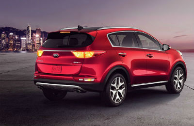 2019 Kia Sportage exterior back fascia and passenger side parked with city in background
