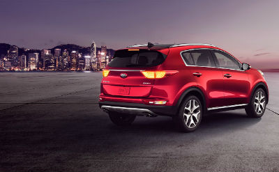 2019 Kia Sportage exterior back fascia and passenger side with city background