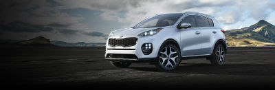 Sparkling Silver 2019 Kia Sportage exterior front fascia and drivers side