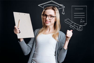 Woman holding empty clipboard with drawn grad cap and diploma