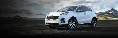 snow white pearl 2019 Kia Sportage exterior front fascia and drivers side