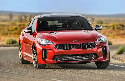 2018 Kia Stinger exterior front fascia and passenger side on desert road