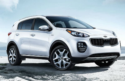 2019 Kia Sportage exterior front fascia and passenger side on snow