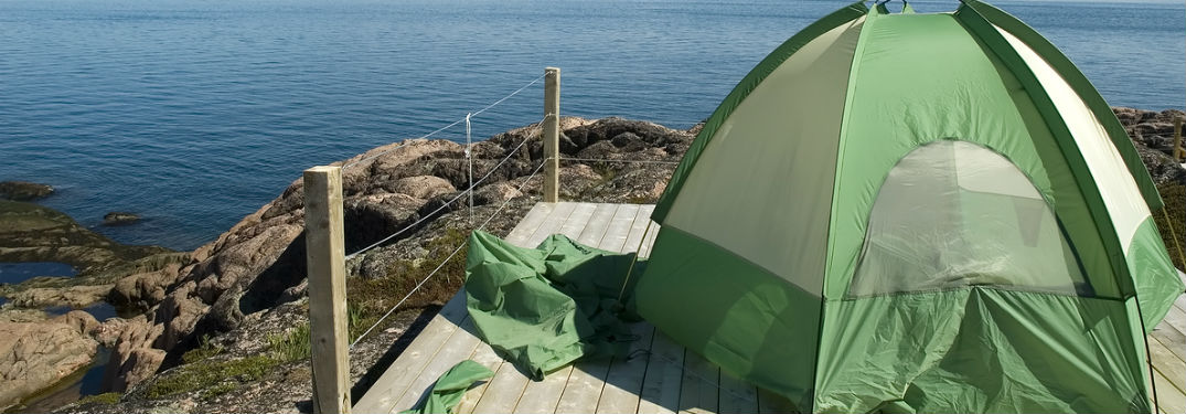 backpacking tent overlooking water
