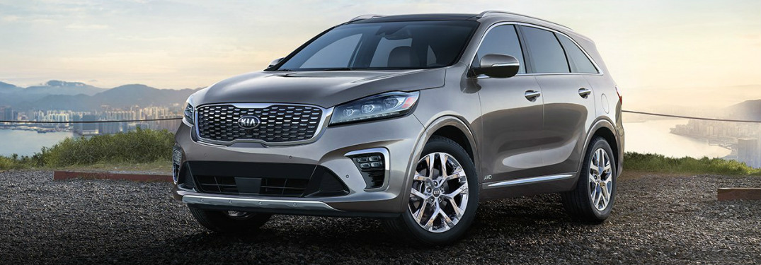 2019 Kia Sorento parked in gravel next to a lake