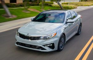 2019 Kia Optima driving down a residential street