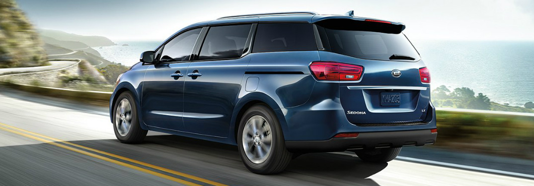 2019 Kia Sedona in Celestial Blue driving on a winding road