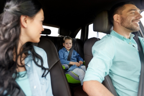 family in vehicle smiling