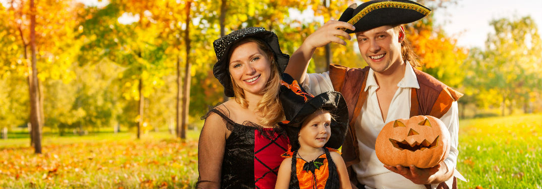 Family dressed in Halloween costumes