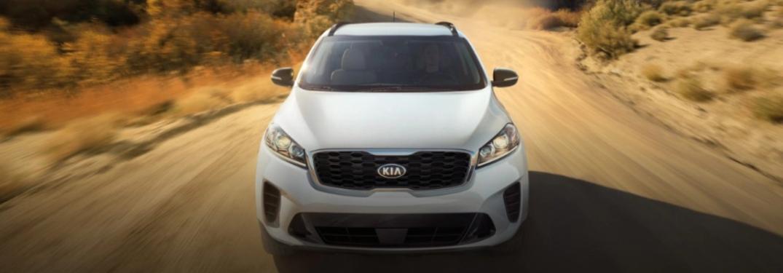 2020 Kia Sorento driving down a dirt road