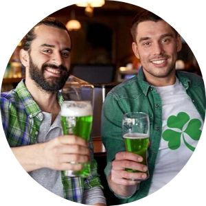 Two men drinking green beer on St. Patrick's Day