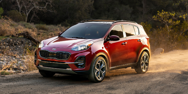 Front view of red 2020 Kia Sportage on off-road path