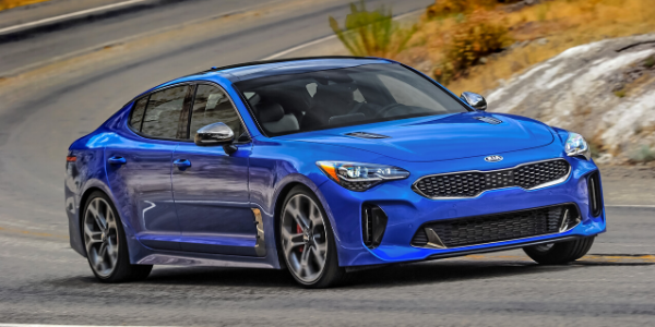 Front view of blue 2020 Kia Stinger on the road