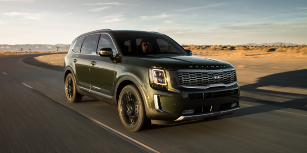 Front view of green 2020 Kia Telluride on the road