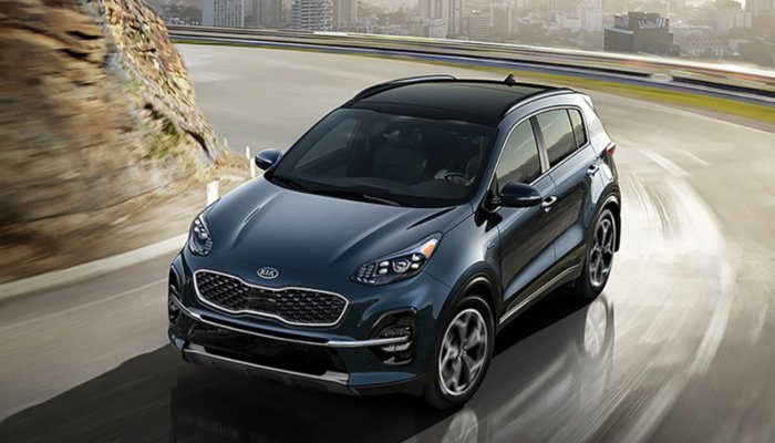 2020 Kia Sportage driving down a curved road
