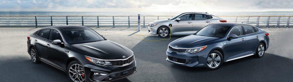Three 2020 Kia Optima models parked in a pier