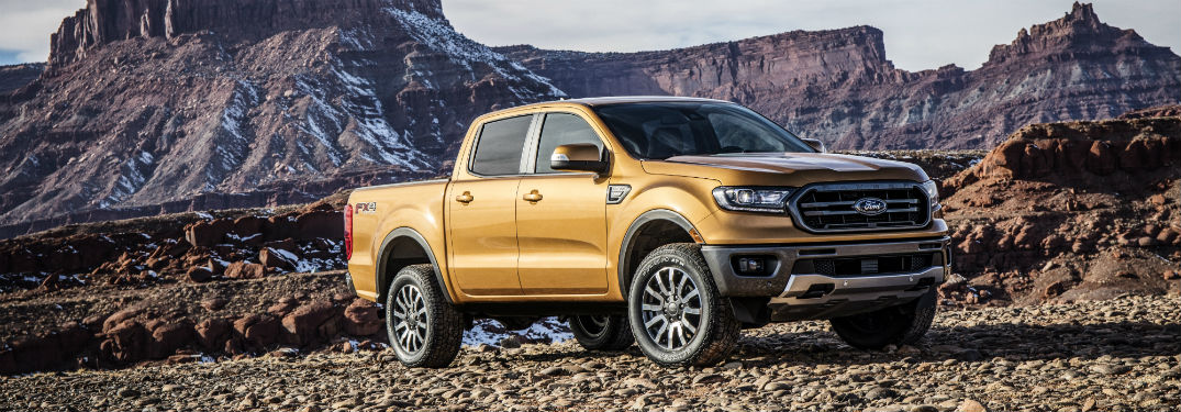 Passenger side exterior view of a gold 2019 Ford Ranger