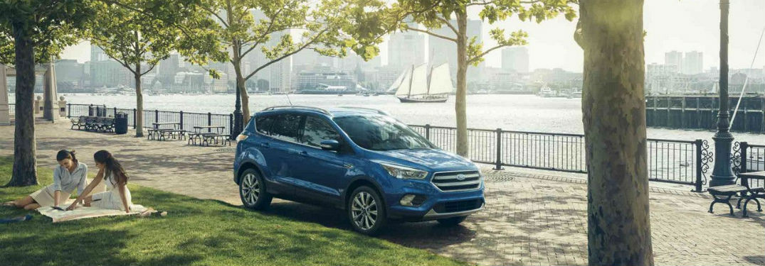 2018 Ford Escape exterior front fascia passenger side parked with girls on blanket in grass