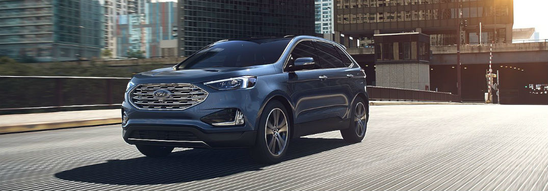 2019 Ford Edge exterior front fascia and drivers side on city road