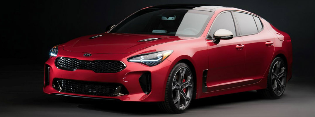 Red 2018 Kia Stinger sitting in a showroom