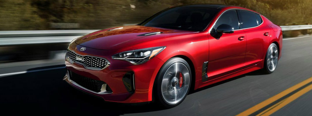 Red 2018 Kia Stinger cruising on a highway