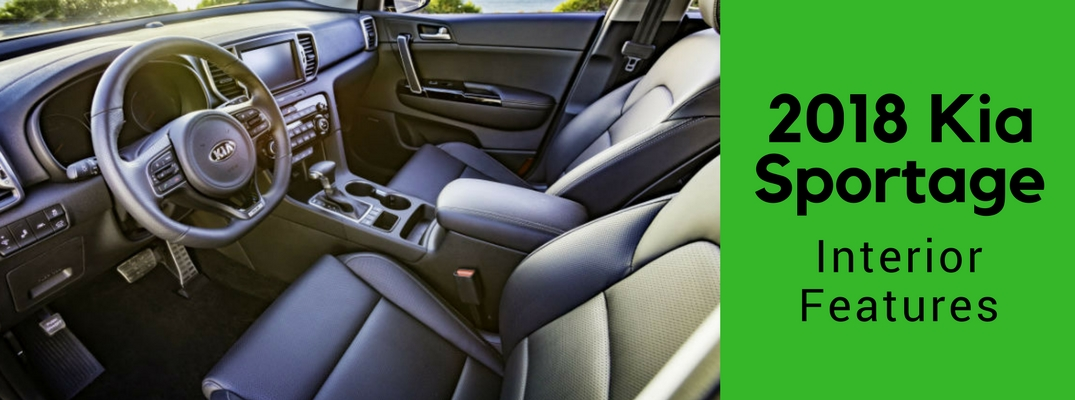 Front seats and dash of 2018 Kia Sportage with green banner