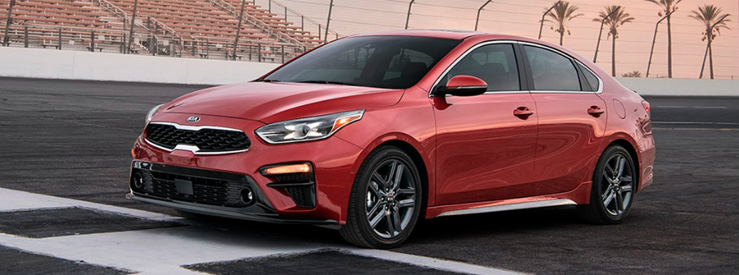 Red 2019 Kia Forte on a race track
