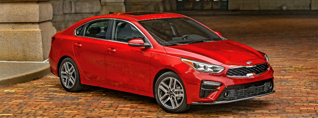 Front/side profile of a red 2019 Kia Forte