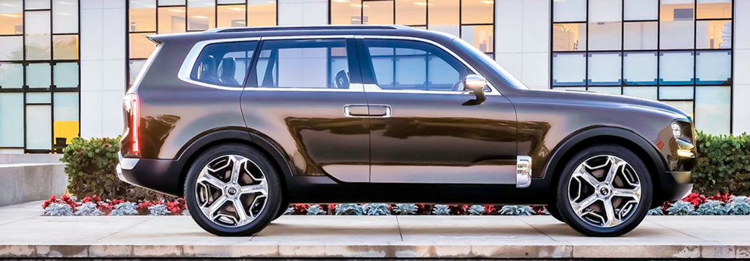 2020 Kia Telluride exterior passenger side profile in front of glass windows