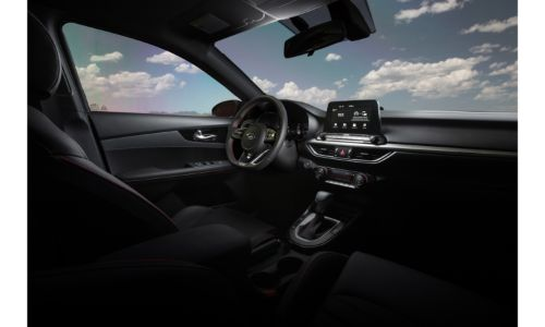 2020 Kia Forte interior showing steering wheel front seats dashboard and windshield