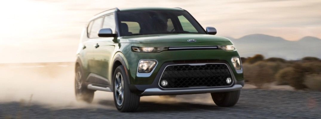 2020 Kia Soul Green driving on dusty road sunset