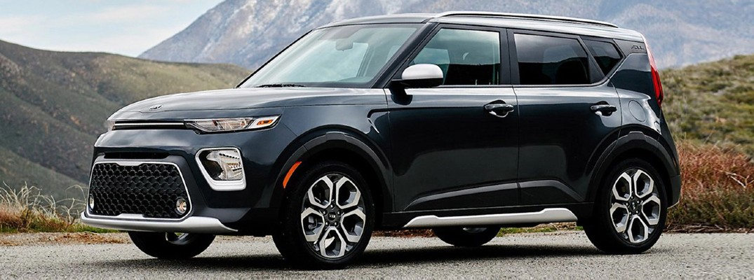 2020 Kia Soul black parked on gravel road with foothills in the background