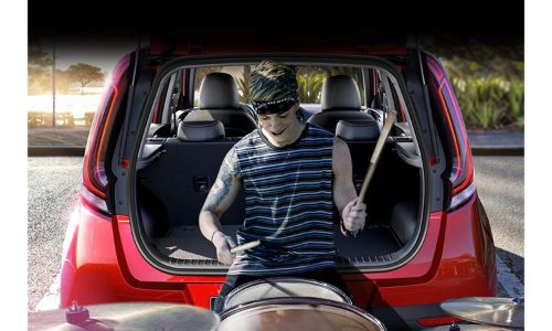 2020 Kia Soul red person sitting in back playing drums