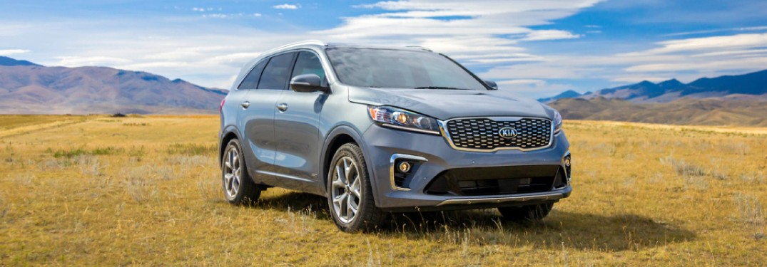 2020 Kia Sorento light paint parked on grassy hill with mountains in background