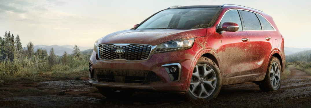 2020 Kia Sorento red paint driving through mud