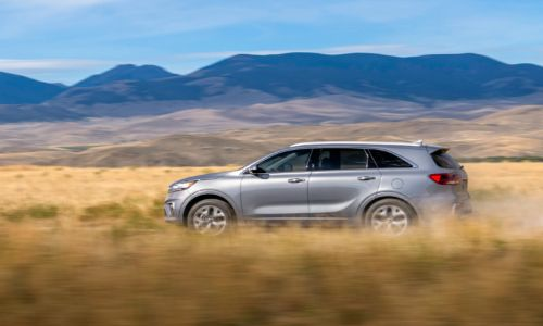 2020 Kia Sorento driving fast through tall grasses