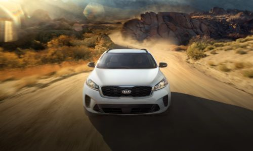 2020 Kia Sorento driving toward shot on dusty road