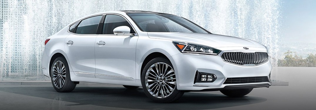 2019 Kia Cadenza white parked in front of water fountains