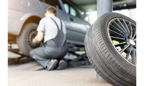 stock photo of tires being changed out in garage