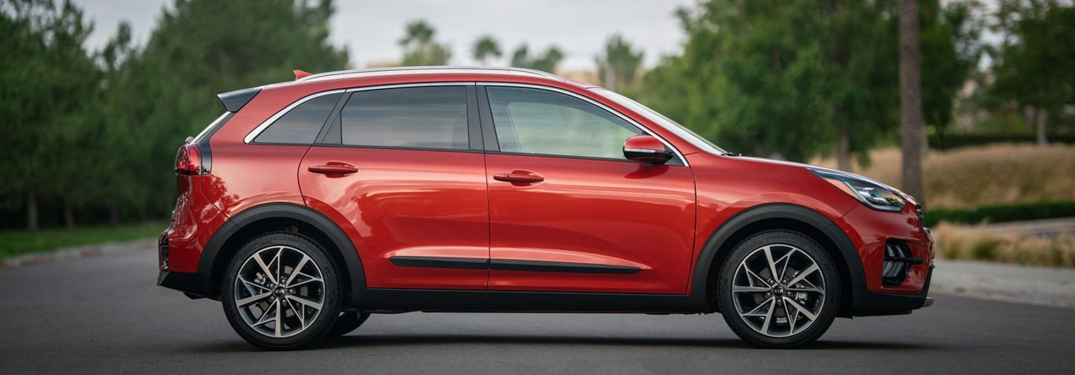 2020 Kia Niro red or orange parked profile view facing right