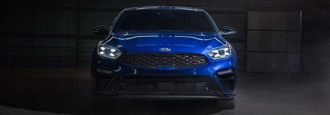 2021 Kia Forte GT Blue head on shot in dark garage